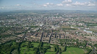 AX110_196 - 6K stock footage aerial video of a wide city view of Glasgow, Scotland