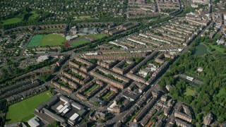 AX110_198 - 6K stock footage aerial video of rows of apartment buildings, Glasgow, Scotland