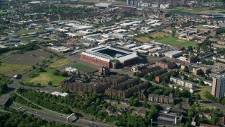 AX110_200 - 6K stock footage aerial video approach Ibrox Stadium, Glasgow, Scotland