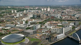 AX110_207 - 6K stock footage aerial video approach office buildings from River Clyde, Glasgow, Scotland