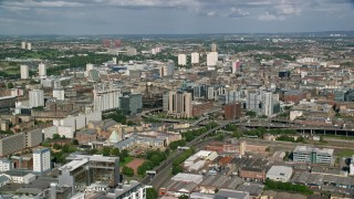 AX110_208 - 6K stock footage aerial video of approaching city office buildings, Glasgow, Scotland