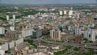 AX110_209 - 6K stock footage aerial video approach office buildings and hotel, Glasgow, Scotland