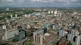 AX110_210 - 6K stock footage aerial video of office buildings and hotel in Glasgow, Scotland