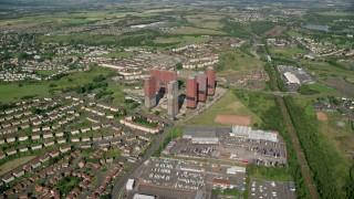 AX110_215 - 6K stock footage aerial video approach apartment buildings near houses, Glasgow, Scotland