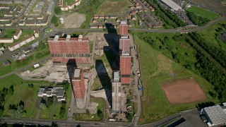 AX110_216 - 6K stock footage aerial video approach tall apartment buildings, Glasgow, Scotland