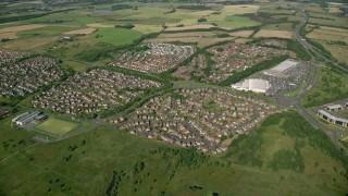 AX110_217 - 6K stock footage aerial video approach suburban residential homes, Glasgow, Scotland