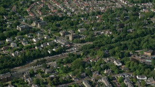AX110_222 - 6K stock footage aerial video of a suburban neighborhood and church, Glasgow, Scotland