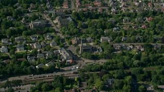 AX110_223 - 6K stock footage aerial video of orbiting a church in a suburban neighborhood, Glasgow, Scotland