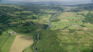 AX110_229 - 6K stock footage aerial video of farms, fields and a river, Cumbernauld, Scotland