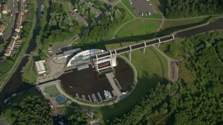 AX111_007 - 6K stock footage aerial video of tilting to a bird's eye of the Falkirk Wheel boat lift, Scotland