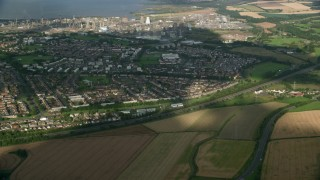 AX111_009 - 6K stock footage aerial video of suburban houses and gas power plant, Falkirk, Scotland
