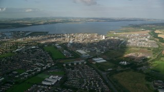 AX111_010 - 6K stock footage aerial video of a natural gas power plant beside the water, Falkirk, Scotland