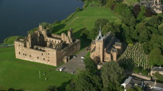 AX111_015 - 6K stock footage aerial video of an orbit of iconic Linlithgow Palace and St. Michael's Parish, Scotland