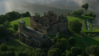 AX111_017 - 6K stock footage aerial video of historic Linlithgow Palace and St. Michael's Parish church, Scotland