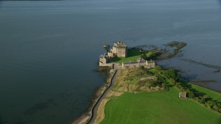 AX111_031 - 6K stock footage aerial video of iconic Blackness Castle by Firth of Forth, Scotland