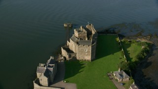 AX111_032 - 6K stock footage aerial video fly over historic Blackness Castle beside the Firth of Forth, Scotland