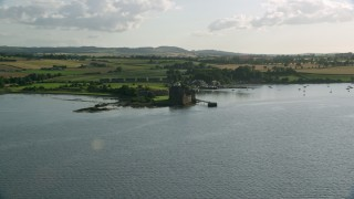 AX111_033 - 6K stock footage aerial video of a view of iconic Blackness Castle seen from River Forth, Scotland