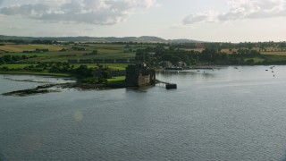 AX111_034 - 6K stock footage aerial video approach historic Blackness Castle from River Forth, Scotland