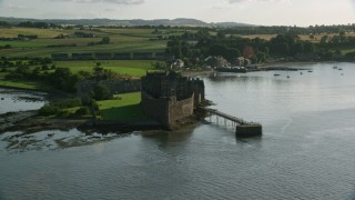 AX111_035 - 6K stock footage aerial video approach historic Blackness Castle from River Forth, Scotland