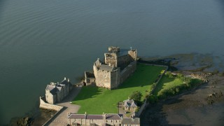 AX111_037 - 6K stock footage aerial video of orbiting the iconic Blackness Castle by River Forth, Scotland
