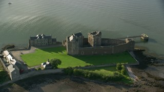 AX111_038 - 6K stock footage aerial video of an orbit of historic Blackness Castle beside the River Forth, Scotland