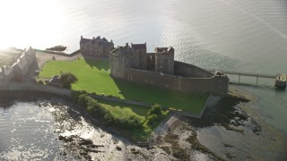 AX111_039 - 6K stock footage aerial video of an orbit of the iconic Blackness Castle on the bank of the River Forth, Scotland