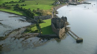 AX111_040 - 6K stock footage aerial video of an orbit of the historic Blackness Castle, seen from River Forth, Scotland
