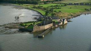 AX111_041 - 6K stock footage aerial video of circling Blackness Castle by River Forth, Scotland
