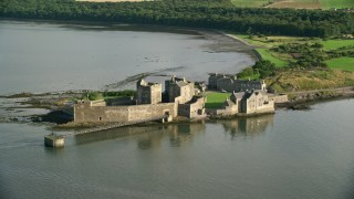 AX111_042 - 6K stock footage aerial video of circling historic Blackness Castle, viewed from River Forth, Scotland