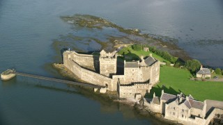 AX111_044 - 6K stock footage aerial video of historic Blackness Castle by River Forth, Scotland