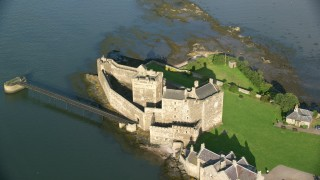 AX111_045 - 6K stock footage aerial video of orbiting Blackness Castle on the side of River Forth, Scotland