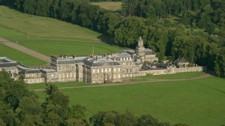 AX111_046 - 6K stock footage aerial video of historic Hopetoun House by wide green fields, Scotland