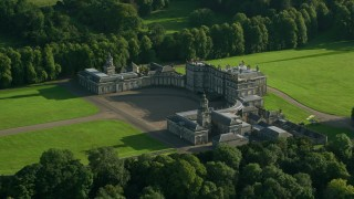 AX111_049 - 6K stock footage aerial video of passing Hopetoun House in Scotland