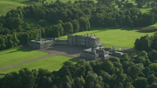 AX111_050 - 6K stock footage aerial video of flying away from historic Hopetoun House in Scotland