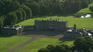 AX111_051 - 6K stock footage aerial video of passing by Hopetoun House in Scotland