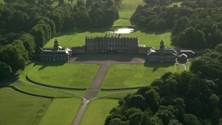 AX111_052 - 6K stock footage aerial video of slowly flying by Hopetoun House in Scotland