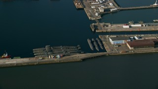 AX111_060 - 6K stock footage aerial video of submarines at Rosyth Dockyard on Firth of Forth, Scotland