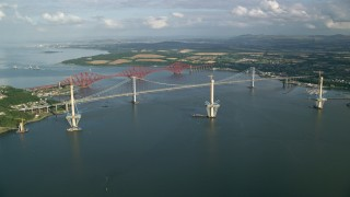 AX111_061 - 6K stock footage aerial video of Forth Road Bridge and Forth Bridge on Firth of Forth, Scotland