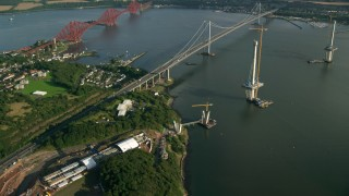 AX111_065 - 6K stock footage aerial video of new bridge construction by Forth Road Bridge on the Firth of Forth, Scotland
