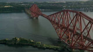 AX111_068 - 6K stock footage aerial video of Forth Bridge on Firth of Forth, Scotland