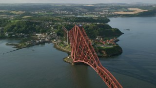 AX111_069 - 6K stock footage aerial video of orbiting Forth Bridge on Firth of Forth, North Queensferry, Scotland