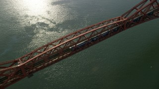 AX111_079 - 6K stock footage aerial video of a commuter train traveling on Forth Bridge over Firth of Forth, Scotland