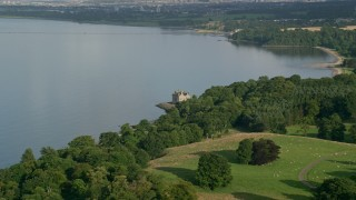AX111_085 - 6K stock footage aerial video of historic Barnbougle Castle beside the Firth of Forth, Edinburgh, Scotland