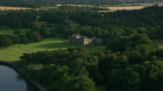 AX111_089 - 6K stock footage aerial video of Dalmeny House and trees in Edinburg,h Scotland