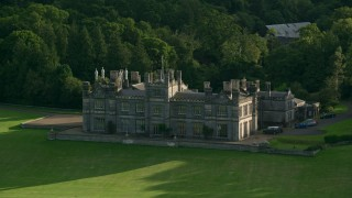 AX111_090 - 6K stock footage aerial video of Dalmeny House beside trees, Edinburgh, Scotland