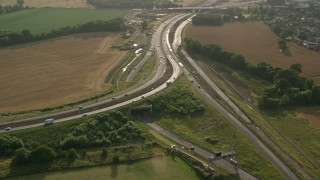 AX111_094 - 6K stock footage aerial video approach M90 Interchange and farmland, South Queensferry, Scotland