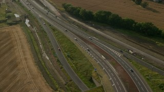 AX111_095 - 6K stock footage aerial video of M90 highway Interchange and farmland, South Queensferry, Scotland