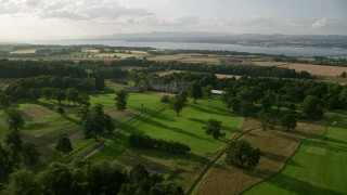 AX111_096 - 6K stock footage aerial video approach historic Dundas Castle in South Queensferry, Scotland