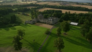 AX111_097 - 6K stock footage aerial video of historic Dundas Castle and countryside, South Queensferry, Scotland