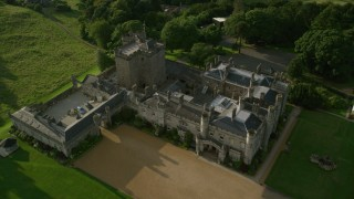 AX111_098 - 6K stock footage aerial video fly over Dundas Castle in South Queensferry, Scotland